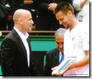 2009 french open - andre agassi hands runner-up trophy to robin soderling