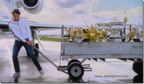 2009 french open - federer pulls dolly full of trophies in humorous west jet congratulatory commercial