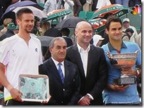 2009 french open - robin soderling, andre agassi and roger federer pose with trophies
