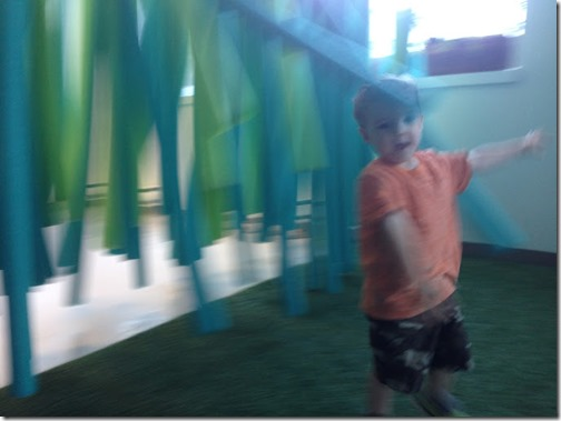 Zach Running through hanging things - discovery centre