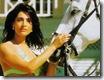 caterina murino - casino royale (2006) holding horse steady on the beach