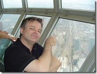 Dale Dietrich in CN Tower Pointing to Home OFfice