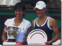 francesca schiavone and samantha stosur hold trophies at french open 2010