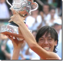francesca schiavone wins french open 2010 - holds up cup