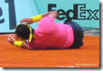 french open 2009 - rafael nadal - the champ goes down - pic 5