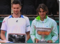 rafael nadal and robin soderling holding French Open 2010 trophies