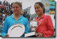 Safina and Ivanovitch hold their 2008 French Open trophies