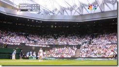 wimbledon 2009 - closing centre court roof - first time 10 - safina serving after play had resumed under closed roof