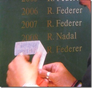 wimbledon 2009 - federer's name being added to the winner's roster in lobby